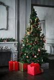 Christmas tree with presents in red boxes. royalty free stock photography