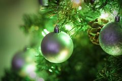 Christmas tree. Decorated christmas tree glowing with shiny decorations background Stock Images