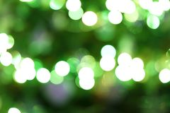 Christmas tree. Decorated christmas tree glowing with shiny decorations background Stock Photos