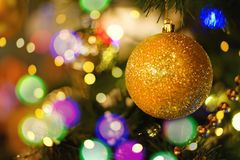 Christmas tree decorated with golden baubles stock photo