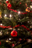 Christmas tree decorated with lights and tinsel Royalty Free Stock Photography
