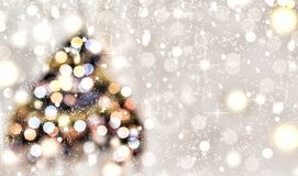 Christmas tree decorated with multicolored lights on a background of falling snow, golden snowflakes. Christmas background. Abstra stock images