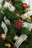 Paper money on a Christmas tree. Christmas tree decorated with paper dollars and Christmas toys Stock Images