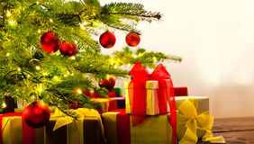 Christmas tree decorated with presents Stock Image