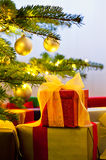 Christmas tree decorated with presents. In living room Stock Photo