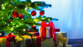 Christmas tree decorated with presents. In living room Royalty Free Stock Photography