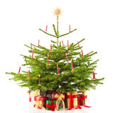 Christmas tree decorated with presents. Over white Royalty Free Stock Photos