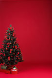 Christmas tree decorated with red balls Royalty Free Stock Images