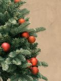 Christmas tree decorated with red balls, on cement background. Christmas tree and red balls decorated Stock Images