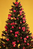 Christmas tree decorated with red balls Stock Photography