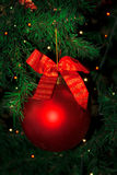 Christmas tree decorated with red bauble hanging stock photo