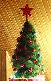 Christmas tree. Decorated with red and blue toy with a star on top Stock Images