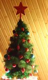 Christmas tree. Decorated with red and blue toy with a star on top Royalty Free Stock Photos