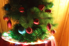 Christmas tree. Decorated with red and blue toy with a star on top Royalty Free Stock Images