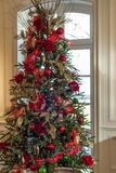 Christmas tree decorated in red and gold ornaments Stock Photo