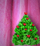 Christmas tree decorated red hearts Royalty Free Stock Image