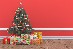 Christmas tree decorated in a red room with gift packs. Christmas Scene: beautiful gift packs rest at the foot of a beautiful Christmas tree decorated in a Stock Photos