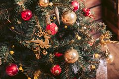 Christmas tree decorated with retro toys. Of red and gold color Royalty Free Stock Photo