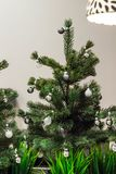Christmas tree decorated with silver balls and white decor.  stock photography
