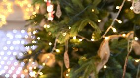 Christmas tree decorated with sparkly christmas tree toys and shining lights. Defocused object