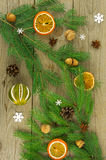 Christmas tree decorated with spices, pine cones and acorns. Royalty Free Stock Photos