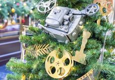 Christmas tree decorated in the style of cinema stock photos
