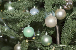 Christmas tree decorated with toys. Colored balls hanging on a branch of a Christmas tree Royalty Free Stock Photo