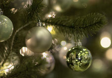 Christmas tree decorated with toys. Colored balls hanging on a branch of a Christmas tree Stock Image