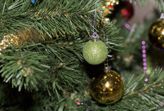 Christmas tree decorated with toys. Colored balls hanging on a branch of a Christmas tree Stock Photography