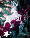 Christmas tree decorated with toys deer Stock Images