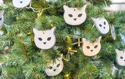 Christmas tree decorated with toys in the form of cats muzzles stock images