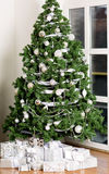Christmas tree decorated with toys. Decorated Christmas tree with garlands and balls Royalty Free Stock Image