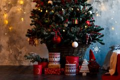 Christmas tree decorated with toys and gifts. Christmas decorated fir tree with gifts and Christmas decor. Christmas tree decorated with toys and gifts Royalty Free Stock Images