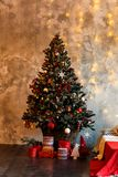 Christmas tree decorated with toys and gifts. Christmas decorated fir tree with gifts and Christmas decor. Christmas tree decorated with toys and gifts Royalty Free Stock Photography