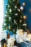 Christmas tree decorated with toys and gifts. Christmas decorated fir tree with gifts and Christmas decor. Christmas tree decorated with toys and gifts Stock Images