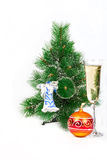 Christmas tree decorated with toys and a glass of Royalty Free Stock Image