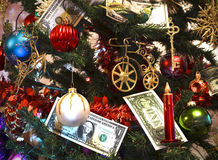 Christmas tree decorated with toys and money Stock Photo