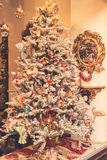 Christmas tree decorated with toys. Vintage Christmas tree decorated with different toys royalty free stock image