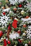 Christmas Tree Decorated With Red Stockings Stock Photography