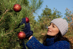 Christmas tree decorating Royalty Free Stock Images
