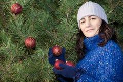 Christmas tree decorating Stock Image