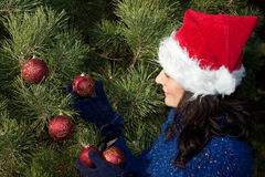 Christmas tree decorating Stock Image