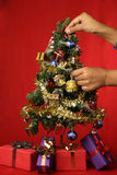 Christmas tree decoration. Decorating Christmas tree with baubles  star and ornaments and gifts Stock Photos