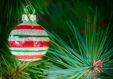 Christmas tree stripy bauble decoration. Christmas tree colorful stripy bauble decoration stock images