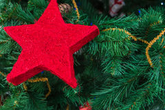 Christmas-tree decoration. S, red star in the Christmas fir tree Stock Photo