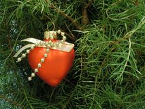 Christmas-tree decoration. Red heart Stock Photos