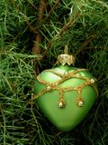 Christmas-tree decoration. Green heart Royalty Free Stock Images