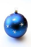 Christmas-tree decoration. A dark blue sphere with asterisks Stock Photos