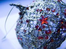 Christmas tree decoration. Christmas tree ornament with red small star Stock Photos