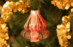Christmas-tree decoration. Celebratory ornament on a branch of an artificial fur-tree Stock Images